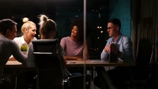 group of casual business people meeting in modern glass office