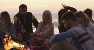 Group of Friends Relaxing At Bonfire Beach Party