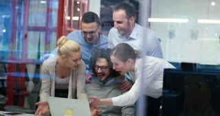 Group of happy young business people in a meeting at startup office