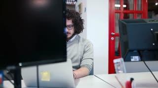 Handsome Software Developer Work In Office