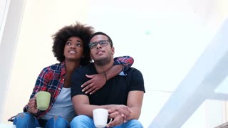 happy afro american couple relaxing afte moving in new home