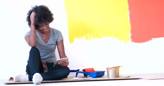 happy afro american  Woman Relaxing During Renovations