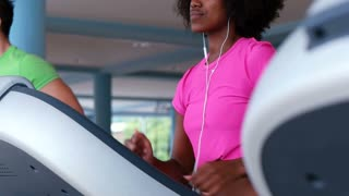 Healthy Happy Young African American Female running on Treadmill