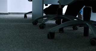Low Angle View Of Businessman Legs, Chairs and table