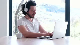 Man At Home Using Laptop Computer Happy Trendy Loft Apartment Listening To Music