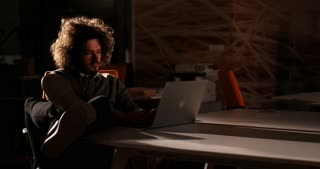 Man surfing the net. Concept of man working overtime.