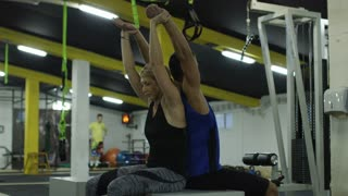 Muscular Fit Couple Doing Sport Exercises In Gym