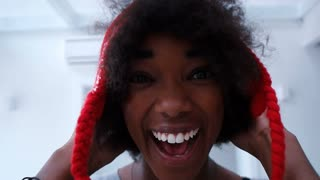 Portrait of black woman with afro hair having fun and smiling