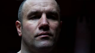 Portrait of strong man on boxing ring