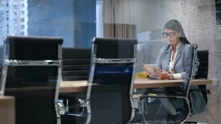 Pretty Business Woman Working Digital Tablet Corporation meeting room