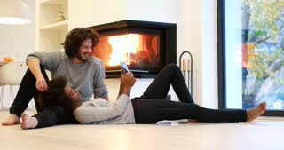 Romantic mixed race Couple By The Cozy Fireplace