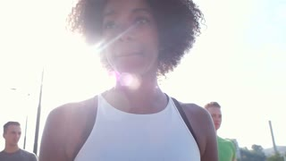Sporty black woman runner preparing for running in slow motion. African