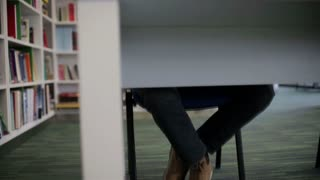 student reading book in school library