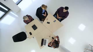 Top View  Business People Meeting At Boardroom Table Discussing plan for startup company