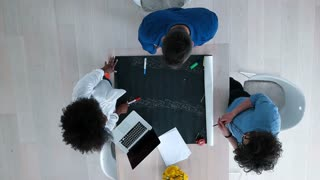 Top View Of Business People Meeting Around Boardroom Table Discussing