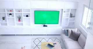 top view of Couple Sitting Together In Front Of The Television with green screen and using devices with green screen