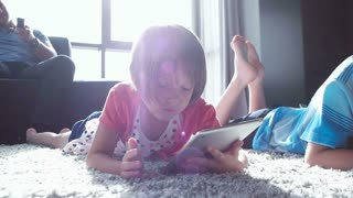 Two Children Playing With Digital Tabletand drowing At Home