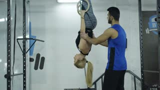 Woman Doing exercises In A Gym On Gymnastic Rings