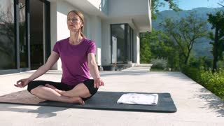 Woman Doing Yoga in front of villa