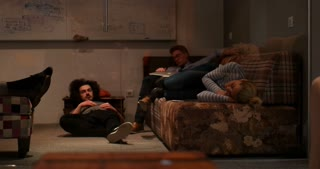 working team sleeping on the sofa. Working overtime concept