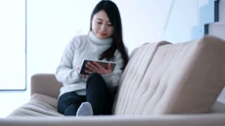 Young asian Woman Using Digital Tablet At Home