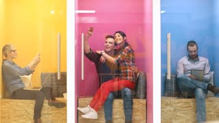 Young business people having fun in colorfull startup office