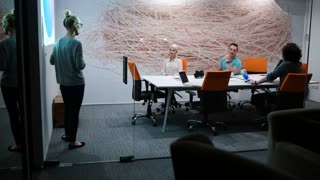 Young Casual Business Group In A Meeting In Creative Office