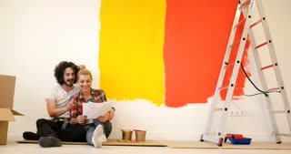 Young Couple Selecting A Color For A Condo