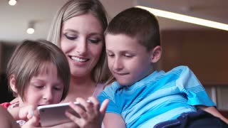 Young Family Using A Tablet To Make Future Plans