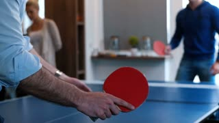 Young Millennial Start Up Workers Playing Ping Pong At Work