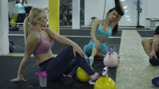 Young People In Crossfit Gym Working Out With Personal Trainer