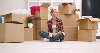 Young Woman Moving into new home. Decorating Her New House