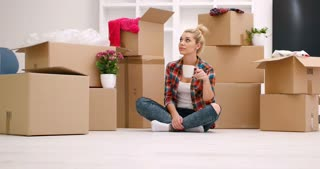 Young Woman Moving Into New Home Decorating Her House