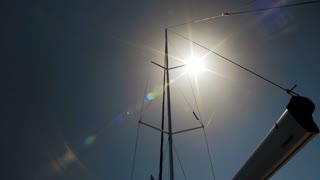 4K Sail Fills with Wind, Sailing in Summer Sun, Sunlight Lens Flare into Camera