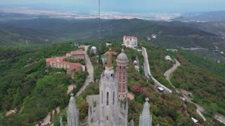 A magical view on top of mount Tibidabo and the Church that stands on it