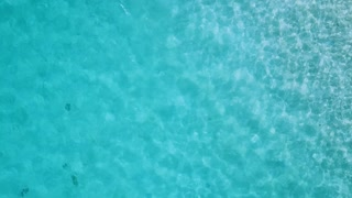 Aerial shoot. Shiny ocean under sunlight from high altitude, sea wave.