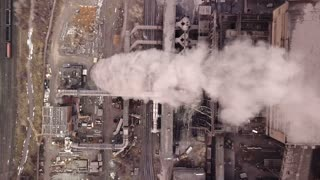 Aerial view. Emission to atmosphere from industrial pipes. Smokestack pipes shooted with drone. Close-up.