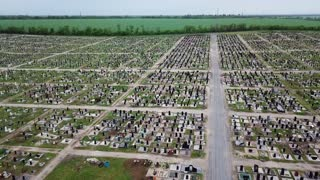 An aerial over a vast cemetery of headstones honors veterans