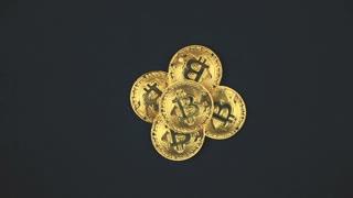 Bitcoin. Crypto currency Gold Bitcoin, BTC, Bit Coin. Macro shot of Bitcoin coins rotated on black background Blockchain technology, bitcoin mining concept. 4K UHD video
