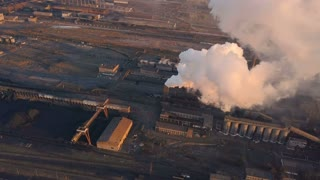 Emission to atmosphere from industrial pipes. Smokestack pipes shooted with drone. Aerial view, close-up.