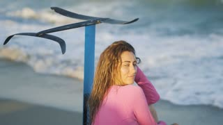 Girl on the beach with a board hydrofoil