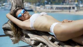 Hot girl lying on beach in the sun.