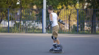 Little boy, seven years old, scatting downhill
