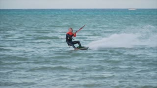 Man Kitesurfing In Ocean In Summer Does Extreme trick failed