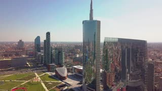 milan city skyline aerial view flying towards financial area skyscrapers
