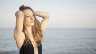 Portrait of beautiful girl on beach at sunset