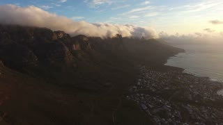 Aerial of Camps Bay, Cape Town in Golden Sunset