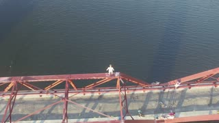 Aerial of Jumping off High Abanadoned Red Bridge