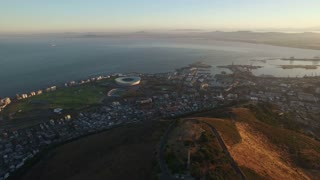 Aerial Panning Shot Over Cape Town City at Sunrise