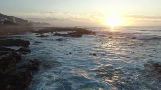 Aerial Shot Flying Low Over Waves During Sunset in Sea Point, Cape Town